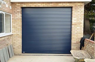 A Gliderol insulated electronically operated Navy Blue roller shutter garage door