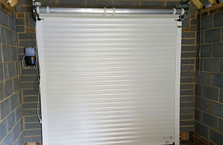 Inside view of insulated electronically operated roller shutter garage door