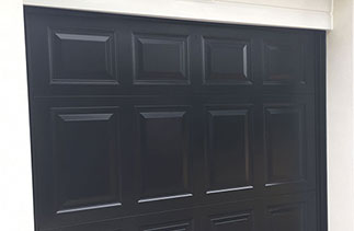 A Garador Beaumont in Black with a Black steel frame. Door was supplied with No handle hole because it is electronically operated. We also installed a new white shiplap upvc fascia. Door fitted in Church Crookham, Hampshire.