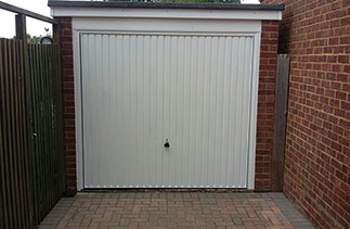 A Garador Carlton framed canopy garage door. Fitted in Mytchett, Surrey. We had excellent service from Right Choice when we wanted to replace our old garage door. We had already obtained a price over the phone from another installer but when i contacted Right Choice, Ben offered to come straight away to give his advice and price. The price was competitive and we were told the works could commence within about 2 weeks. We ordered the door and when it arrived early Ben asked if we could have it installed earlier than planned. Ben and his team arrived and within no time the old door had been removed  and the new door fitted. They were polite, clean and tidy installers and Ben certainly pays a lot of attention to detail. Excellent installation and we recommend them highly. Alan Spooner.