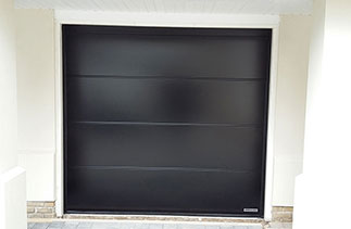 A up close picture of One of the Three sectional garage doors fitted in the previous picture. Fitted in Egham, Surrey.