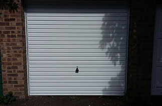 A Garador White steel up and over garage door, fitted on retractable plus door gear with a white steel frame. Door fitted in Camberley, Surrey.