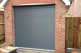 A Gliderol Anthracite compact insulated roller shutter garage door fitted in Alton, Hampshire.