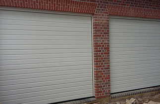 Two of Three Hormann S – ribbed sectional garage doors in Ral 9001. Fitted behind the structural openings. Fitted in Beaconsfield, Buckinghamshire