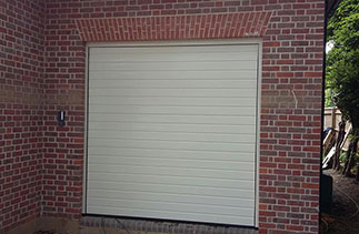 One of Three Hormann S – ribbed sectional garage doors in Ral 9001. Fitted behind the structural opening complete with a external wireless key pad. Fitted in Beaconsfield, Buckinghamshire