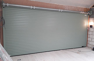The inside view of a Sws Seceuroglide Excel Roller Shutter garage door fitted with no internal box. Fitted in Woking, Surrey.