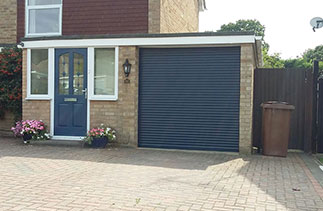 A Blue 55mm compact roller shutter garage door, fitted with matching guides and a matching full box. Fitted in Frimley, Surrey.