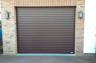 A Gliderol Mahogany insulated roller shutter garage door fitted in Iver Heath, Berkshire