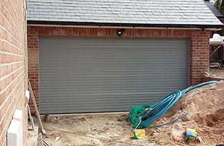 A Seceuroglide Excel Roller shutter garage door finished in Ral 7042. Fitted to plot 1 in Alton, Hampshire.