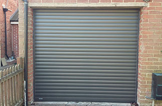 A Seceuroglide Excel Roller Shutter garage door in Graphite. Fitted in Camberley, Surrey. I wanted to use someone local to install a new electric garage door and i came across Right Choice while searching online. I cannot fault the service or product in any way, and Ben was so wonderful to deal with from the first contact right up to until the job was completed. I feel very lucky that i managed to find this business and would highly recommend them for anyone who wants attention to detail and excellent quality from a friendly, professional local business. Sue Lucas.