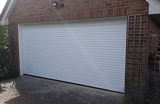 A Sws Seceuroglide Excel Roller Shutter garage door fitted in West End, Surrey.