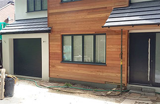 A Sws Seceuroglide Excel, insulated roller shutter garage door in Anthracite. Fitted in Woking, Surrey.
