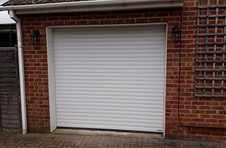 A White Gliderol 77 insulated, electronically operated Roller Shutter Garage Door fitted in Ashvale, Hampshire.
