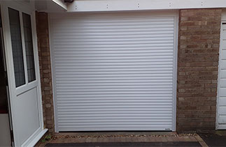 A White Gliderol 55mm compact insulated Roller Shutter Garage Door fitted in Yatley, Surrey.