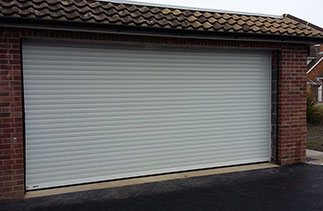 A White Seceuroglide Excel insulated roller shutter garage door fitted in Chichester, West Sussex.