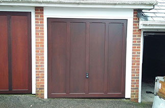 A Woodrite Standerwick up and over garage door, fully finished in Mahogany with a fully finished white Ral soft wood timber frame. Fitted in Guildford, Surrey.