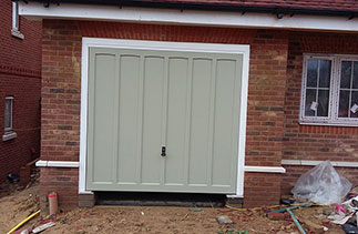 A Woodrite timber up and over garage door supplied in a colour match to Farrow & Ball French Grey. Fitted to plot 4 in Hartley Wintney, Hampshire.